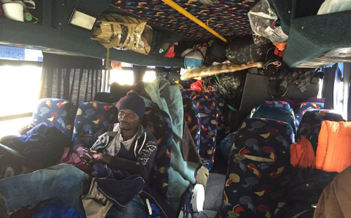 A trip to Malawi was meant to be two days, but these people have been stuck in this broken bus for over a month. Picture: Vumani Mkhize/EWN.