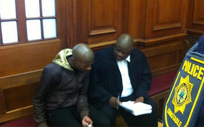Anni Dewani's alleged killer Xolile Mngeni and his lawyer Matthews Dayimani in court on 17 September 2012. Picture: Graeme Raubenheimer/EWN