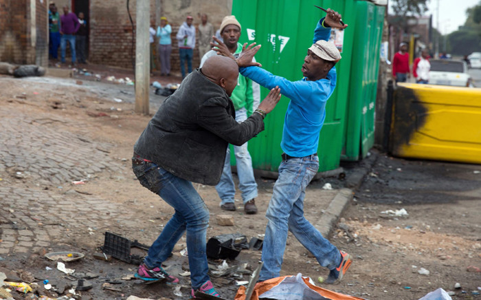 The fatal stabbing of Mozambican national Emmanuel Josias in Alexandra captured by James Oatway of the Sunday Times.