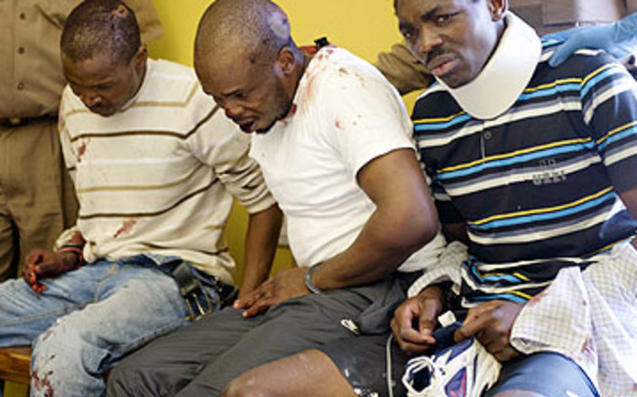 Bongani Moyo (L) and his co-accused Khubulani Sibanda and Leon Ngcube after their prison break failed on 14 March 2012.