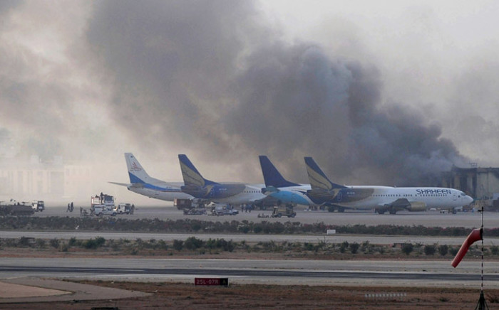Smoke rises after militants launched an assault at Jinnah International Airport in Karachi. Picture: AFP.