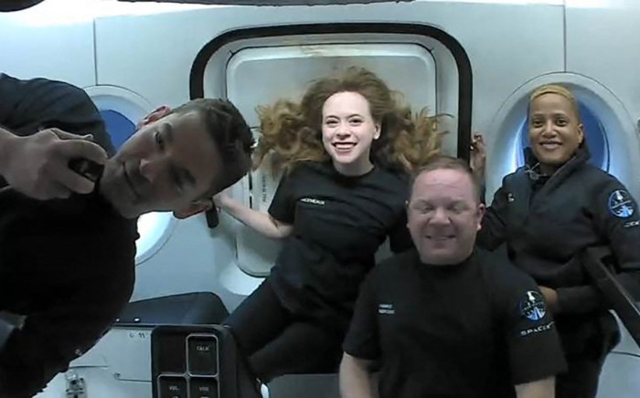 This file photo shows the Inspiration4 crew (L-R) Jared Isaacman, Hayley Arceneaux, Christopher Sembroski and Sian Proctor in orbit.  Picture: AFP/courtesy of Inspiration4