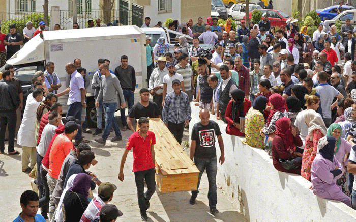 People wait to receive the bodies of loved ones in the Tunisian town of Sfax on 4 June 2018 after more than 50 migrants drowned in the Mediterranean on the previous day, the majority off the coasts of Tunisia and Turkey.  Picture: AFP