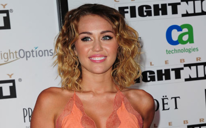 Actress Miley Cyrus arrives at the Muhammad Ali's Celebrity Fight Night XVIII on March 24, 2012 in Phoenix, Arizona. The event supports the fight against Parkinson's disease and this year also celebrates Ali's 70th birthday. Picture: AFP.