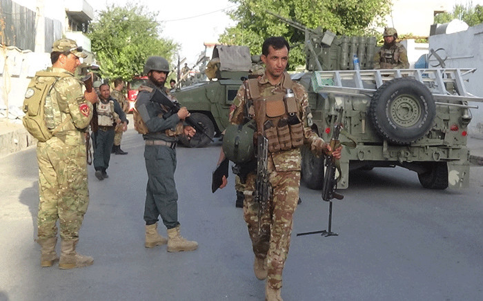 FILE: Afghan security forces stand guard at the site of an attack in Jalalabad on 28 July 2018. Picture: AFP