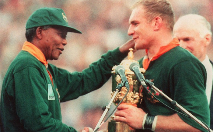 South African rugby team captain Francois Pienaar (right) is congratulated by South African President Nelson Mandela after South Africa won the Rugby World Cup final against New Zealand 24 June 1995 in Johannesburg. Picture: AFP.