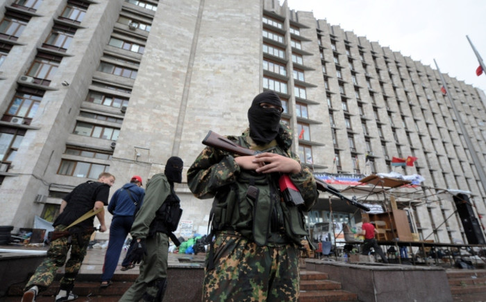 A pro-Russian militant guards a regional state building that was seized by separatists in eastern Ukrainian city of Donetsk. Picture:AFP.