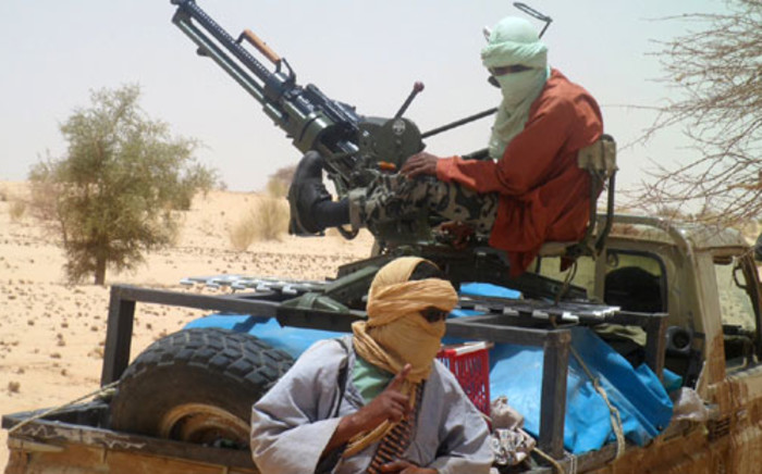 FILE:A picture taken on 24 April, 2012 shows Islamists rebels of Ansar Dine near Timbuktu, in rebel-held northern Mali. Picture: AFP