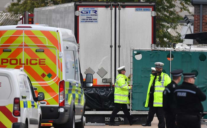 British police officers work near a lorry, found to be containing 39 dead bodies, as they work inside a police cordon at Waterglade Industrial Park in Grays, east of London, on 23 October 2019. Picture: AFP.