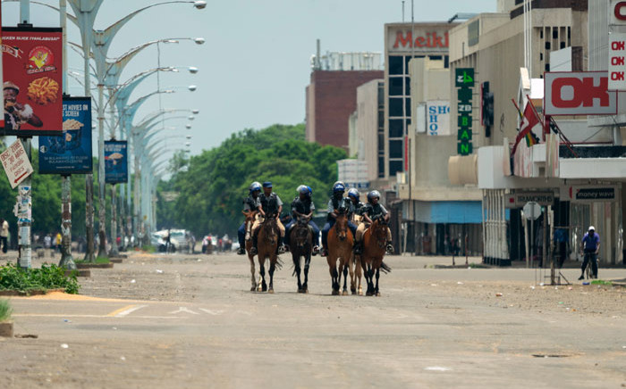 Mounted police patrol in Bulawayo on 16 January 2019, as shops and offices remain closed for business in the central business district following violent protests in the country triggered by a sharp, sudden rise in fuel prices. Picture: AFP