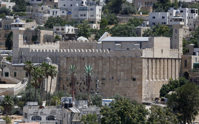 A picture taken on June 29, 2017 shows a view of the Cave of the Patriarchs, also known as the Ibrahimi Mosque, which is a holy shrine for Jews and Muslims, in the heart of the divided city of Hebron in the southern West Bank. On July 7, 2017 UNESCO declared in a secret ballot the Old City of Hebron in the occupied West Bank a protected heritage site. Hebron is home to more than 200,000 Palestinians, and a few hundred Israeli settlers who live in a heavily fortified enclave near the site known to Muslims as the Ibrahimi Mosque and to Jews as the Cave of the Patriarchs. Picture: AFP.