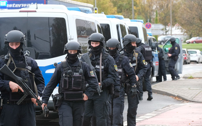Policemen walk through a street close to the site of a shooting in Halle an der Saale, eastern Germany, on 9 October 2019. Picture: AFP