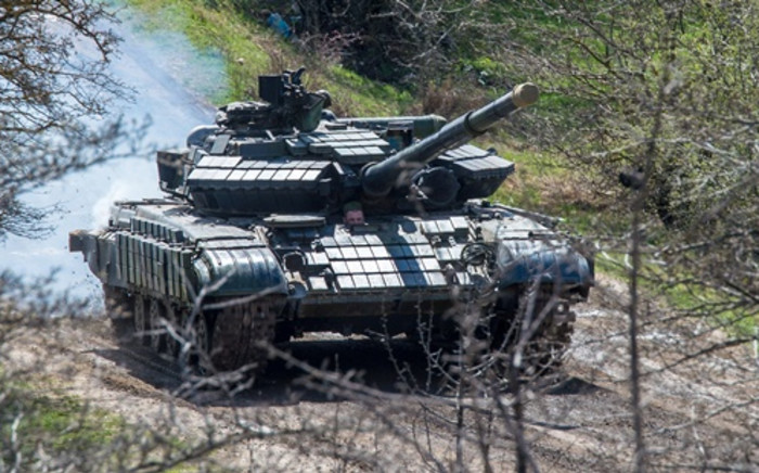 A Russian tank rolls outside a former Ukrainian military base in Perevalnoye, near the Crimean capital Simferopol on 27 March. Picture:AFP.