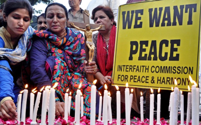 FILE: Pakistani civil activists take part in a protest vigil against the killing of a Christian couple who were burnt alive for alleged blasphemy, in Kot Radha Kishan, in Karachi, Pakistan, 07 November 2014. Picture: EPA.