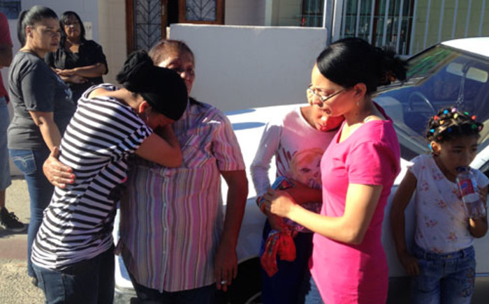 Relatives of five men who were shot dead in a house in Mitchells Plain on 19 March 2013. Picture: Regan Thaw/EWN