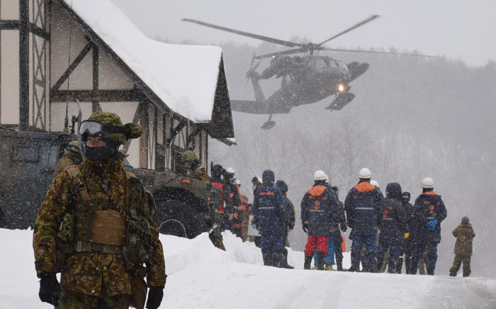 FILE: A helicopter from Japan's Self-Defence Force (JSFD) is seen at a ski resort during a rescue operation after the volcanic eruption of Mount Kusatsu-Shirane in Kusatsu town, Gunma prefecture on 23 January 2018. Picture: AFP
