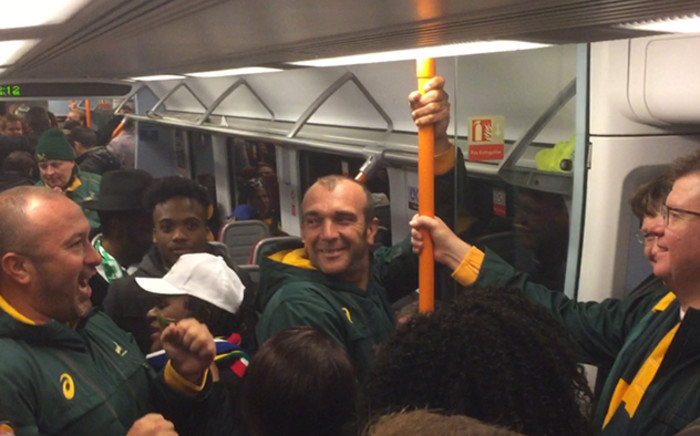 Happy South Africans sing on the train from Twickenham, after the Bok's quarterfinal victory over Wales. Picture: Vumani Mkhize/EWN.