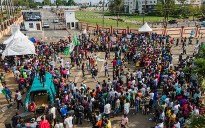 Protesters gather at the front of Alausa in Lagos on October 20, 2020, after the Governor declared 24-hour curfew ias violence flared in widespread protests that have rocked cities across the country. Benson Ibeabuchi / AFP