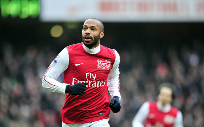 FILE: Arsenal's French striker Thierry Henry celebrates scoring their seventh goal during their 7-1 win in the English Premier League football match between Arsenal and Blackburn Rovers at The Emirates Stadium in north London, England on 4 February 2012. PICTURE: Glyn Kirk/AFP