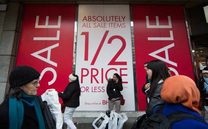 Shoppers walk along Oxford Street to find bargains in central London, on December 26, 2014, in Boxing Day sales. Picture: AFP.