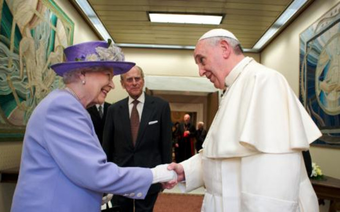 Britain's Queen Elizabeth (L), accompanied by her husband the Duke of Edinburgh Prince Philip (C), as she greets Pope Francis at the Vatican, on 3 April. Picture: AFP.