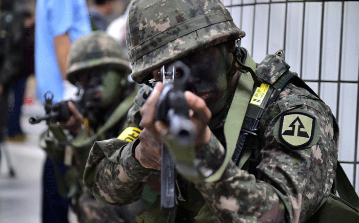 FILE: South Korean soldiers take a position during an anti-terror drill on the sidelines of South Korea-US joint military exercise, called Ulchi Freedom Guardian, at a subway station in Seoul on 19 August 2015.  Picture: AFP