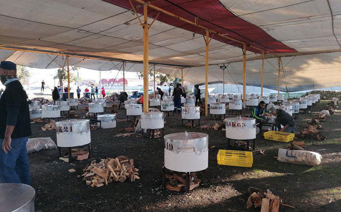 Some of the 179 pots being used to cook food to be distributed by the Nakhlistan feeding scheme on Eid on 14 May 2021. Picture: Nakhlistan/Facebook