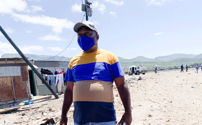 Masiphumele community leader Howard Mbana wants government to fulfill its promise of building temporary units following a fire in the area. Picture: Kaylynn Palm/EWN.