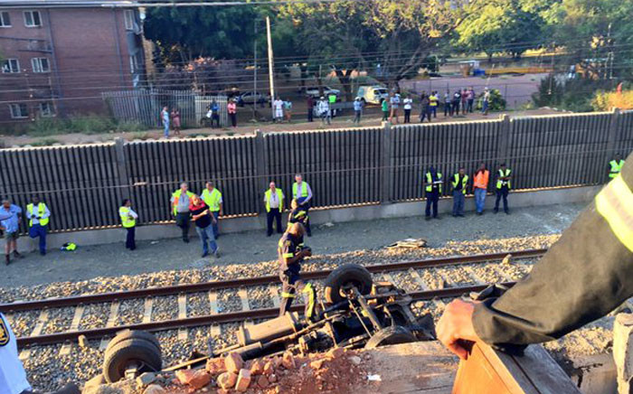 The wreckage after a truck crashed through concrete barriers onto the Gautrain line on 20 April 2016. Picture: Emily Corke/EWN