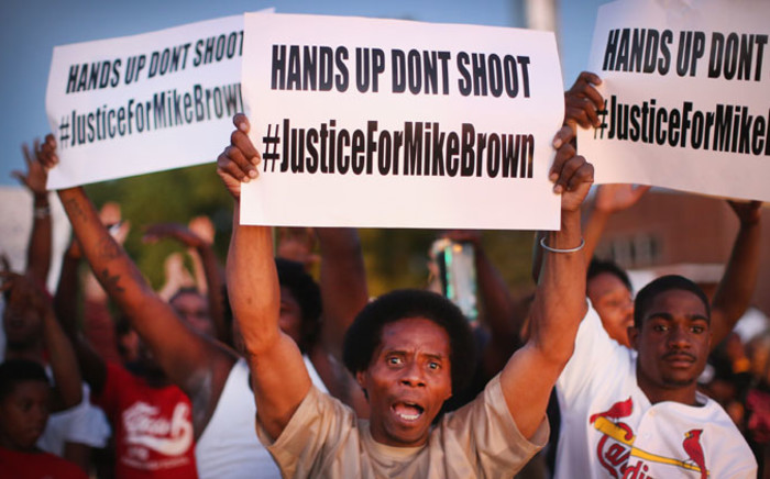 Demonstrators protest the killing of teenager Michael Brown. United states, St. Louis on 12 August. Picture: AFP