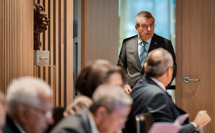 FILE: International Olympic Committee (IOC) president Thomas Bach (R) enters next to a bust representing IOC founder Pierre de Coubertin prior to an executive board meeting at the IOC headquarters in Lausanne, on 3 December 2019. Picture: AFP