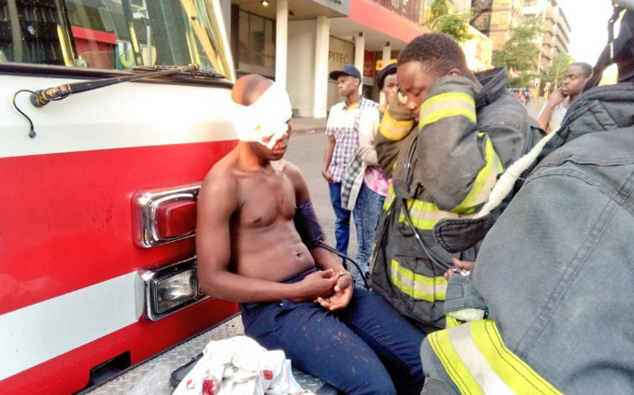 Firefighters treat a student who was shot just above the eye with a rubber bullet. Picture: Victor Magwedze/EWN.