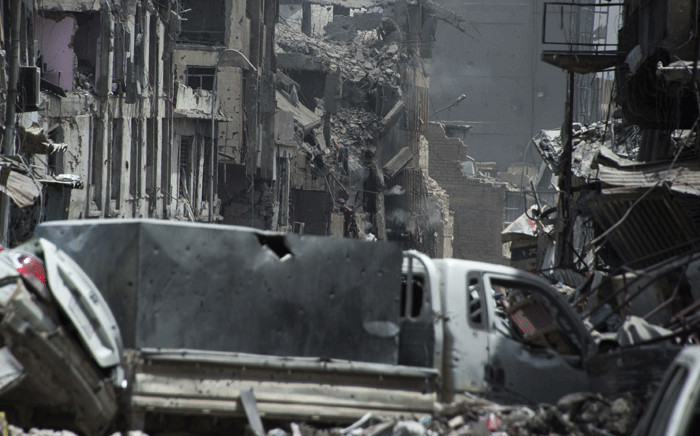 Smoke billows from a building where Islamic State (IS) group fighters are taking shelter as Iraqi forces fight them, in the Old City of Mosul on 3 July, 2017. Picture: AFP