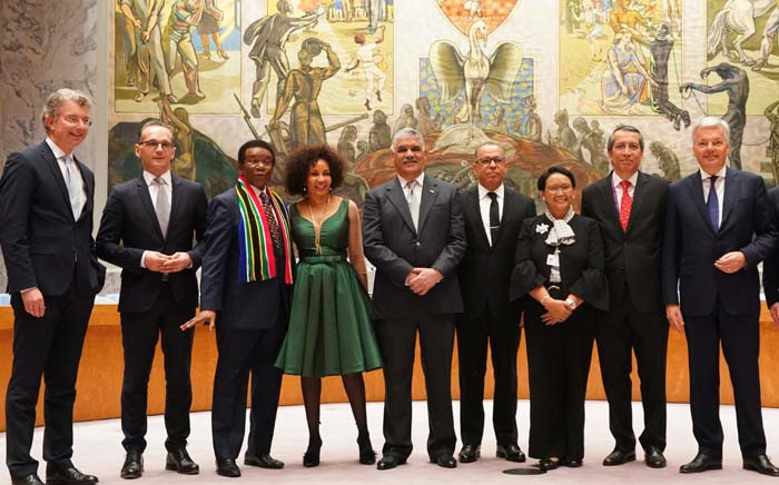 Foreign Ministers and UN Ambassadors from Germany, South Africa, Dominican Republic, Indonesia, and Belgium, pose for photos on the floor of the Security Council after a General Assembly meeting to elect the five non-permanent members of the Security Council June 8. Picture: AFP