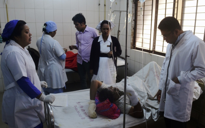 A Bangladeshi resident who suffered burn injuries after a petrol bomb attack on a bus is treated by a doctor at the Dhaka Medical College Hospital in Dhaka on February 3, 2015. Anti-government protesters firebombed a bus full of sleeping passengers in eastern Bangladesh on February 3, killing seven in spiralling political unrest aimed at toppling Prime Minister Sheikh Hasina. Picture: AFP.