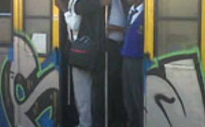 FILE: Commuters hang out of a Metrorail train in Cape Town. Picture: Supplied