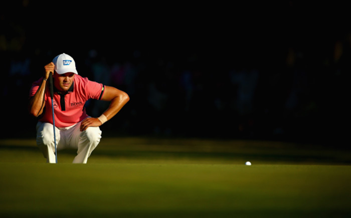 Martin Kaymer of Germany lines up his putt on the 15th green during the third round of the 114th US Open at Pinehurst Resort & Country Club, Course No. 2, 14 June 2014, Pinehurst, North Carolina. Picture: AFP.