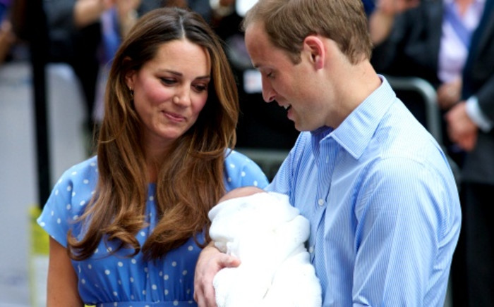 Prince William and Catherine, Duchess of Cambridge show their new-born baby boy to the world's media, standing on the steps outside the Lindo Wing of St Mary's Hospital in London on 23 July 2013. Picture: AFP/ANDREW COWIE