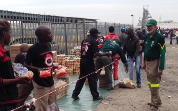FILE: Relief group the Gift of the Givers will hand out food parcels to miners who have been living on cats, rodents and wild vegetables after losing their jobs at the Aquarius mine in 2009. Picture: Vumani Mkhize/EWN