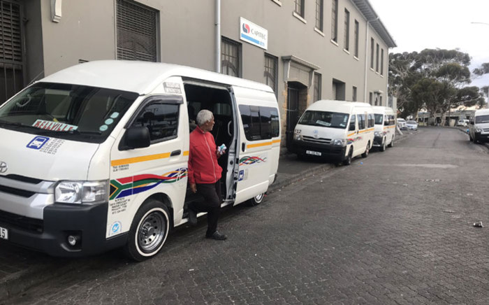 FILE: A taxi operator waits to sanitise the hands of passengers in Wynberg on 24 March 2020. Picture: Lizell Persens/EWN.