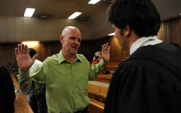 Andre Gouws gestures while appearing in the North Gauteng High Court in connection with Chanelle Henning's murder. Picture: Werner Beukes/SAPA