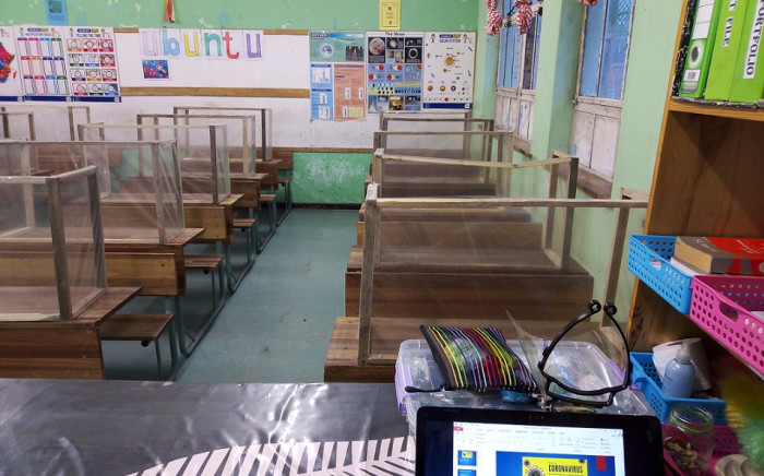 FILE: Classroom desks at Talfalah Primary School are fitted with handmade Covid-19 protective screens. Image: Supplied