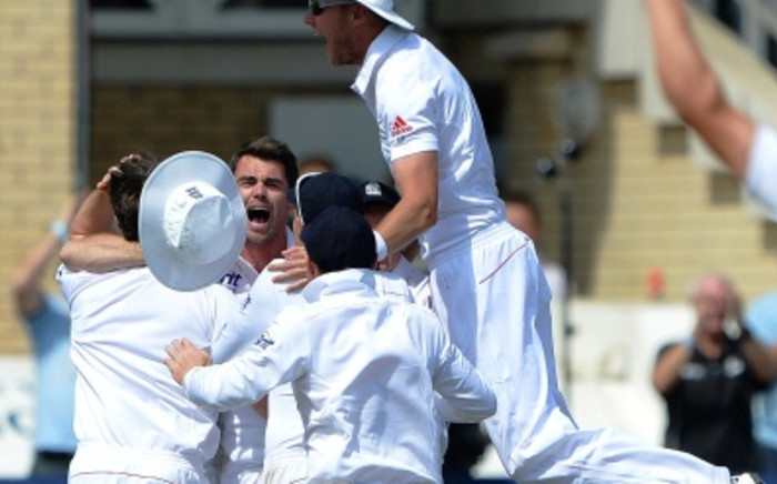 England's James Anderson (C) celebrates with teammates after taking the final wicket of Brad Haddin for 71 during play on the fifth day of the first Ashes cricket test match between England and Australia at Trent Bridge in Nottingham, central England on 14 July, 2013. England won the test by 14 runs and take a 1-0 lead in the best of five series. Picture:AFP