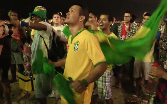 Hundreds of Brazil fans watch in shock as their country was knocked out of the World Cup after they were beaten 7-1 by Germany in the semifinals on 8 July 2014. Picture: Christa Eybers/EWN.