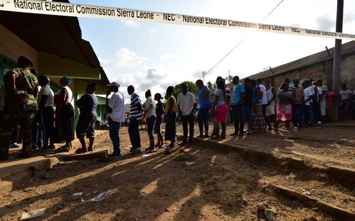 People queue to vote in the general elections on 7 March at a polling station in Freetown. More than 3.1 million voters are registered for the polls across the small West African nation. Picture: AFP.