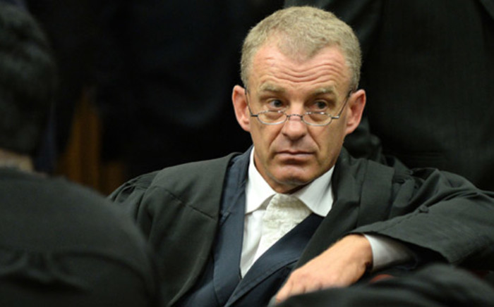 State prosecutor Gerrie Nel is seen during a break in proceedings at the murder trial of double amputee Paralympian Oscar Pistorius at the North Gauteng High Court in Pretoria 4 March 2014. Picture: Pool