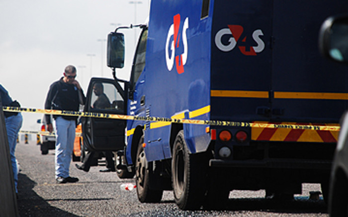 FILE: A security guard was shot dead and four others were wounded at the Black Chain Shopping Centre.