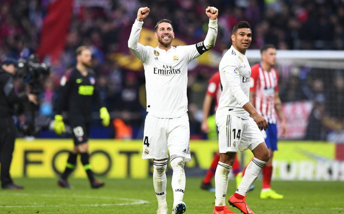 Real Madrid's Spanish defender Sergio Ramos celebrates at the end of the Spanish league football match between Club Atletico de Madrid and Real Madrid CF at the Wanda Metropolitano stadium in Madrid on 9 February 2019. Picture: AFP