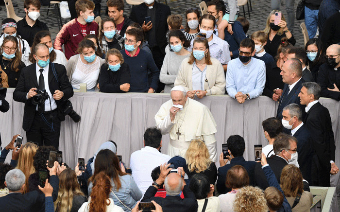 Pope Francis blesses blows his nose as he arrives on May 12, 2021 at San Damaso courtyard in The Vatican to resume his weekly outdoors general audience with the public after a six-month absence due to the coronavirus crisis. Picture: Tiziana Fabi / AFP