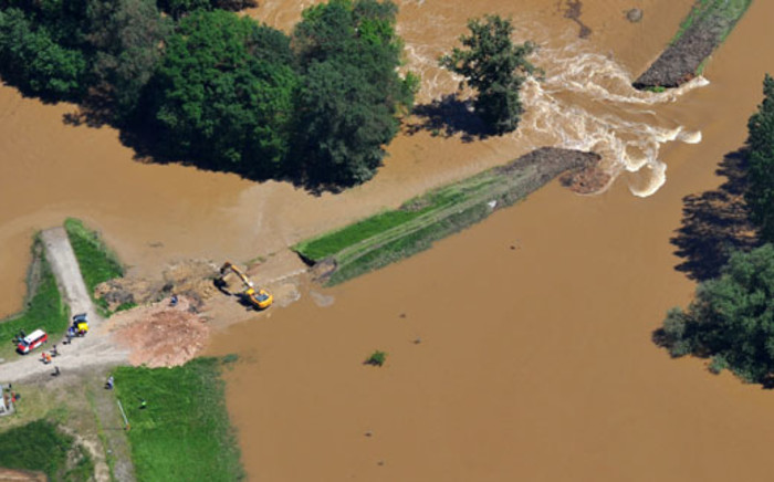 An aerial view shows a dam breaking near Loebnitz, eastern Germany, on 5 June 2013. Chancellor Angela Merkel pledged 100 million euros in emergency aid for flood-ravaged areas as surging waters that have claimed at least 12 lives. Picture: AFP/MATTHIAS HIEKEL
